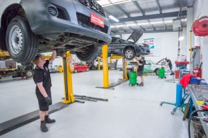 Mechanics working on commercial vehicle and fleet servicing