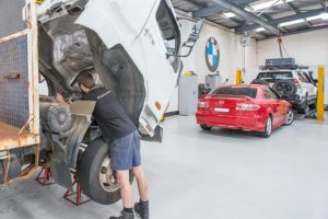 mechanic working on truck and bus servicing